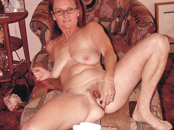 Pretty with glasses shows her pussy