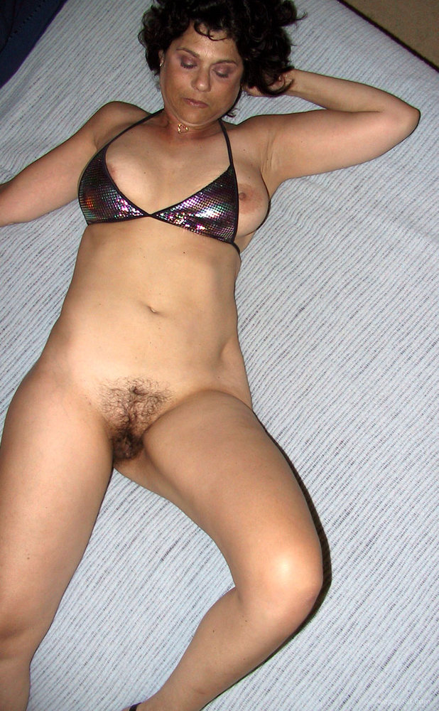 Brunette Bends Over And Shows Us Amazingly Hairy Pussy