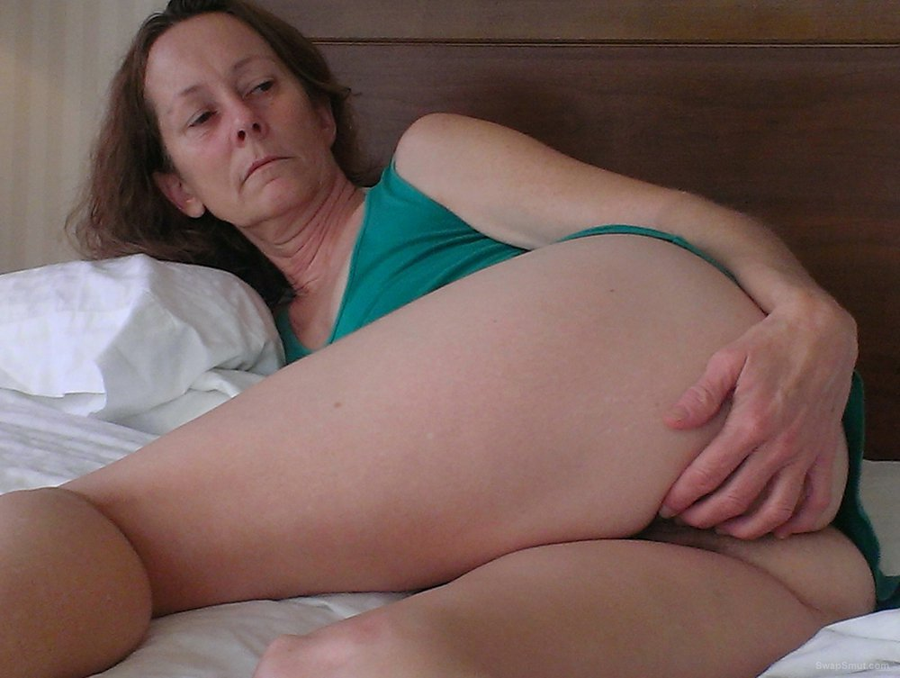 Masturbating Her Hairy Pussy In Bed