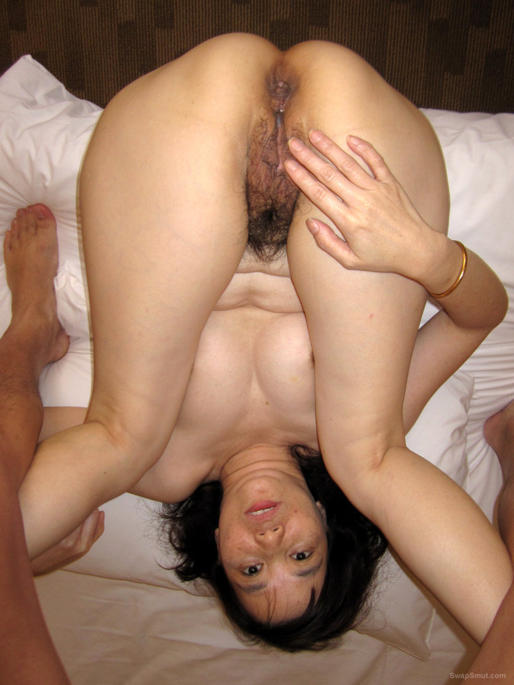 Sexy Asian Girl Spreads Hairy Snatch