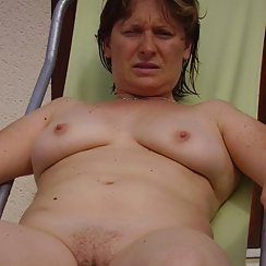 Mature Woman Sun Bathing Shows Hairy Pussy