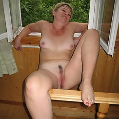 MILF Relaxes With A Large Cock Deep Inside Of Her Hairy Pussy