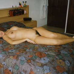 Babe With Hairy Pussy Lays On Bed