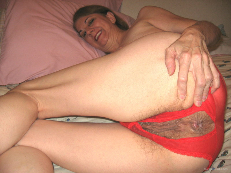 MILF Shows Tits And Hairy Pussy While Wearing Hot Lingerie