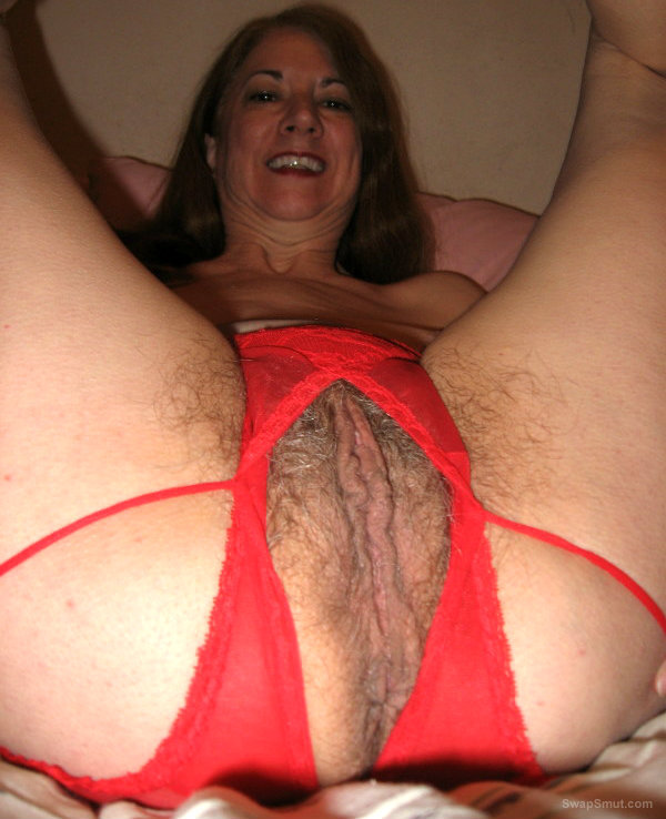 Milf shows her tits and hairy pussy