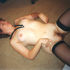 Hot Babe Laying On Her Back With Hairy Pussy Spread