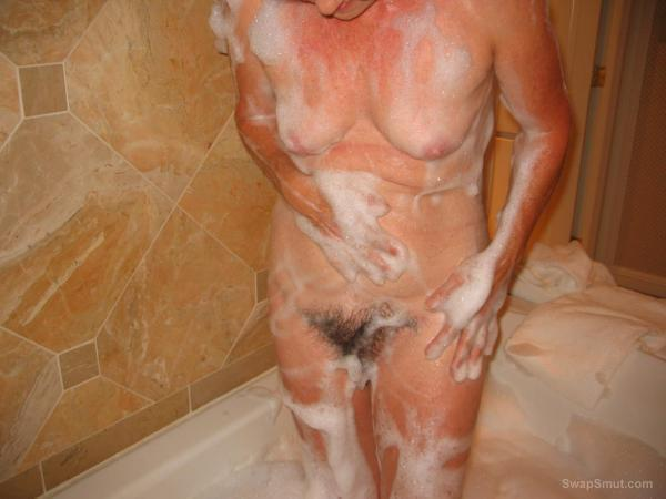 Getting All Soapy Before Playing With Her Hairy Pussy