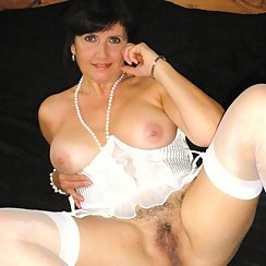 Smoking Hot MILF Lays Back And Shows Hairy Pussy