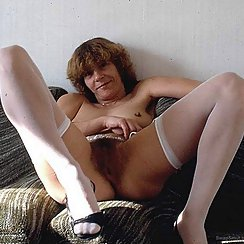 Mature Babe Shows Hairy Twat With Stockings