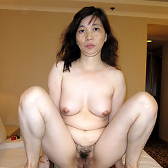 Hairy Babe Shows Her Asian Pussy