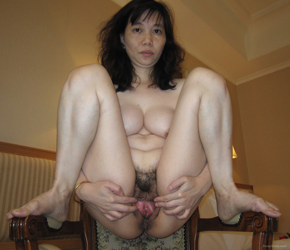 Tasty Asian Girl Spreads Her Hairy Snatch