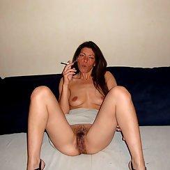 Smoking Babe With Very Hairy And Dark Bush