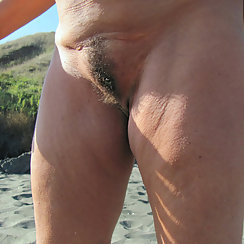 Showing Off Her Sunkissed Hairy Pussy In The Great Outdoors