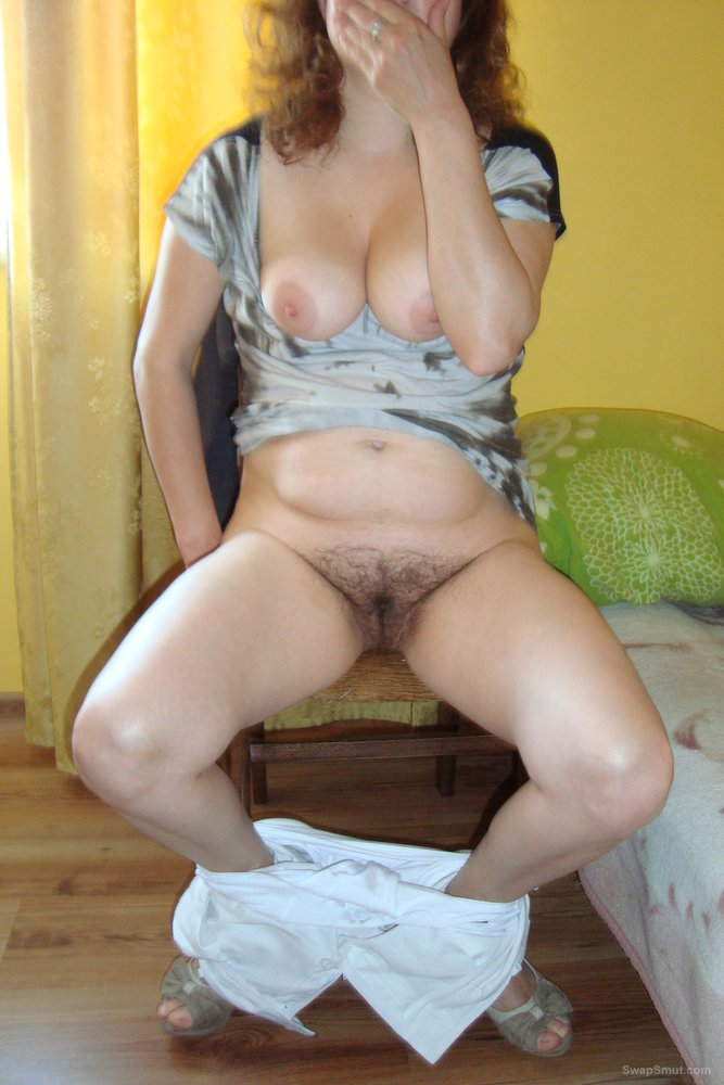 Hot Babe Lifts Up Her Dress And Exposes Hairy Pussy