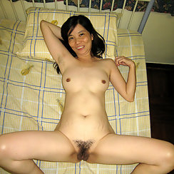Laying On The Bed, She's Happy And Incredibly Horny