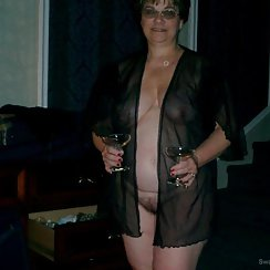 Busty Mature Babe Has A Drink And Shows Us Her Hairy Pussy