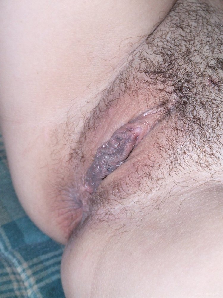 Using A Toy On Her Hairy Pussy