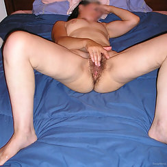 Masturbating Her Hairy Pussy Without A Care In The World