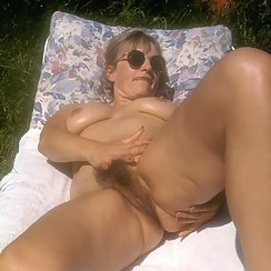 Rubbing Her Bushy Pussy Outdoors