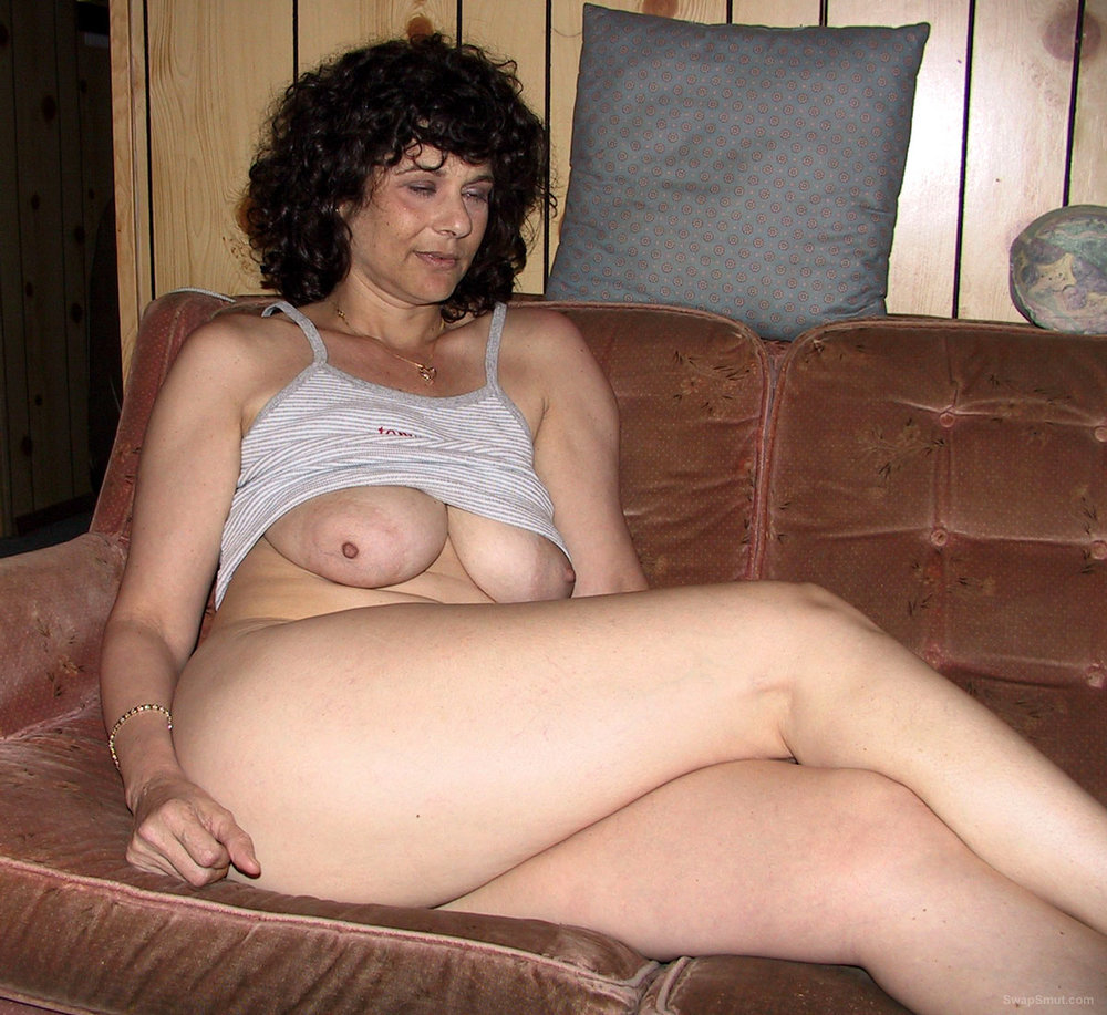 Hot Brunette Lays On Couch With Big Tits Exposed